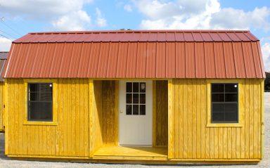 A barn style cabin with a loft